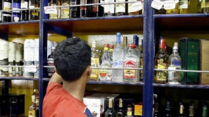 Telangana dips into liquor cash, prices hiked