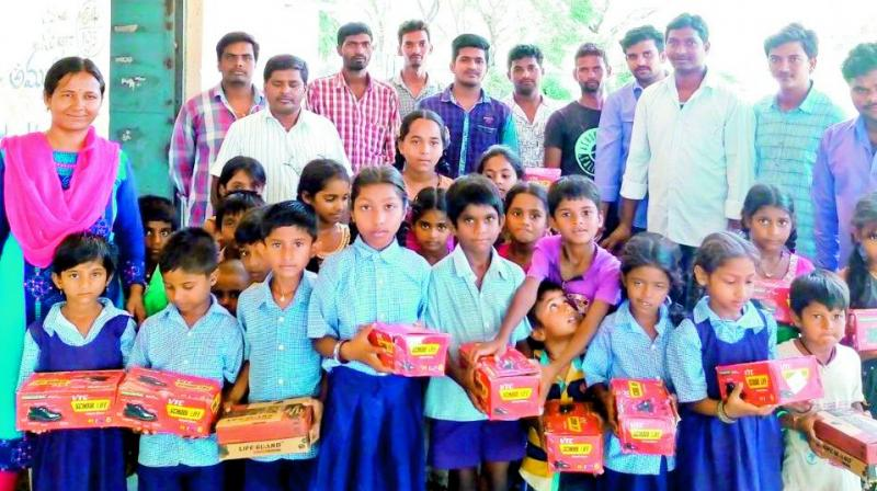 Youth donate shoes to schoolchildren in Warangal Rural district