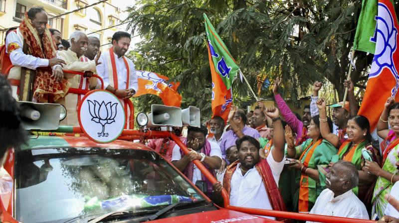 BJP accuses KCR, KTR of mocking democracy