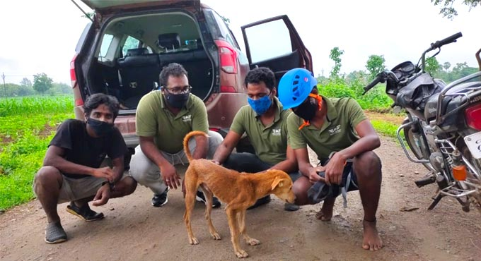 AWCS members rescue dog from deep well in Warangal Rural